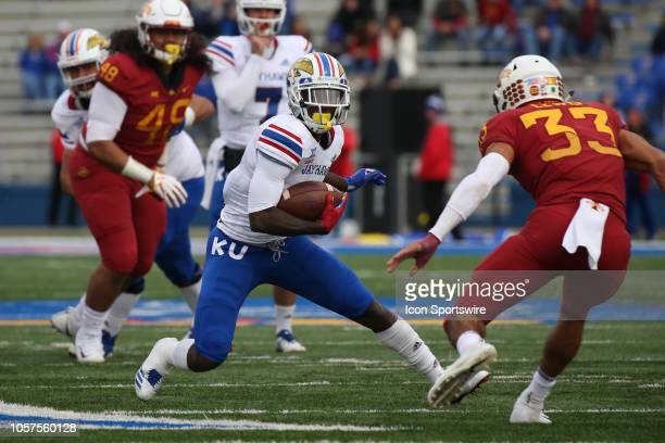 Kansas Jayhawks wide receiver Steven Sims Jr makes a cut on Iowa State Cyclones defensive back Braxton Lewis in the second quarter of a Big 12...