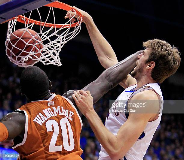 Kansas' Jeff Withey dunks over Texas' Alexis Wangmene during the first half at Allen Fieldhouse in Lawrence, Kansas, on Saturday, March 3, 2012....