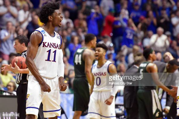Kansas' Josh Jackson and Frank Mason led the Jayhawks on a torrid secondhalf run as they put a 9070 licking on Michigan State on Sunday March 19 2017...