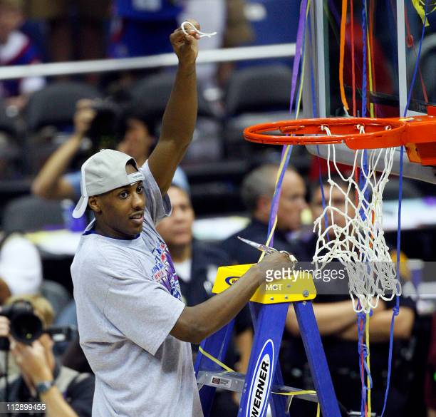 Kansas' Mario Chalmers makes a cut from the net after the Jayhawks 7568 win over the Memphis Tigers in the NCAA Men's Basketball Championship game at...