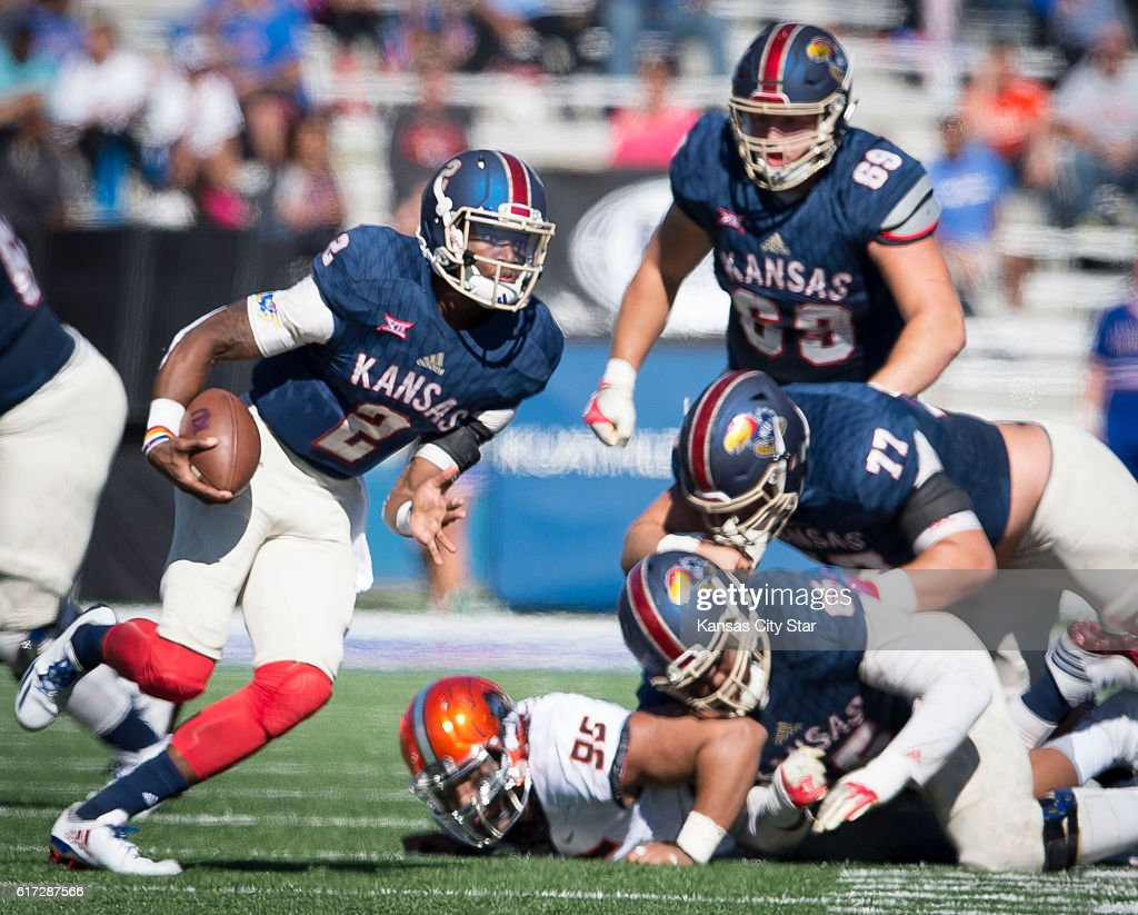 Kansas quarterback Montell Cozart (2) scrambles for a gain in the third quarter against Oklahoma State at Memorial Stadium in Lawrence, Kan., on Saturday, Oct. 22, 2016. Oklahoma State won, 44-20.