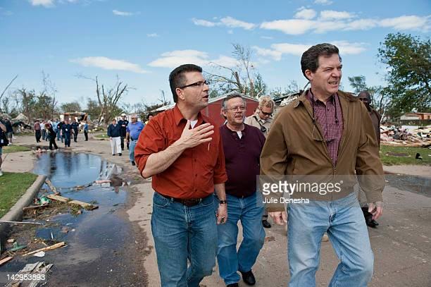 Kansas Rep Tim Howell and Kansas Gov Sam Brownback tour the tornadodamaged Pinaire Mobile Home Park on April 15 2012 in Wichita Kansas The storms...