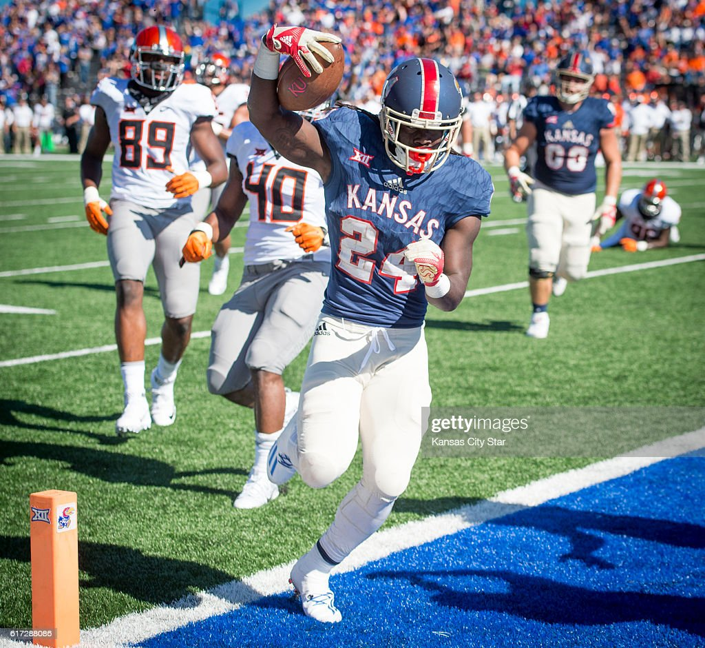 Kansas running back Taylor Martin (24) crosses the goal line to score the Jayhawks' only rushing touchdown of the game, in the third quarter against Oklahoma State at Memorial Stadium in Lawrence, Kan., on Saturday, Oct. 22, 2016. Oklahoma State won, 44-20.