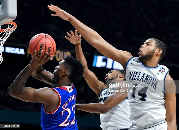 Kansas' Silvio De Sousa puts up a shot against Villanova's Mikal Bridges and Omari Spellman in the first half during an NCAA Tournament national...