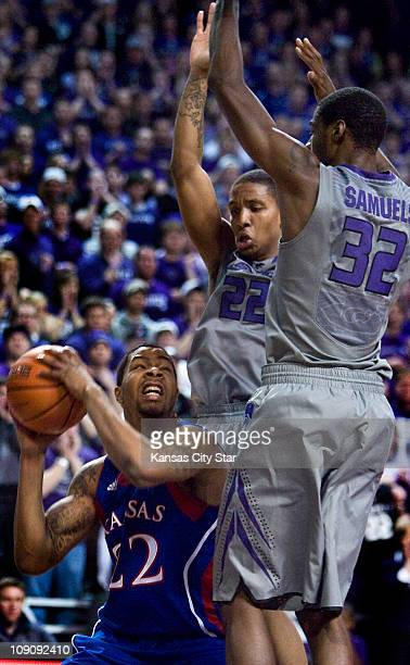 Kansas State defenders Rodney McGruder and Jamar Samuels guard Marcus Morris of Kansas during the first half of play Monday February 14 in Manhattan...