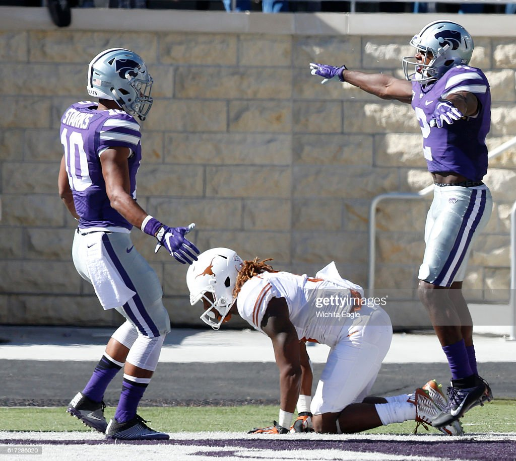 Kansas State defensive backs DJ Reed (2) and Donnie Starks (10) celebrate after Reed knocked away a long pass to Texas wide receiver Armanti Foreman (3) on fourth-and-long at Snyder Family Stadium in Manhattan, Kan., on Saturday, Oct. 22, 2016. Kansas State won, 24-21.