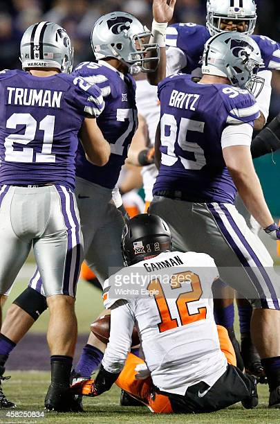 Kansas State defensive lineman Travis Britz leaves Oklahoma State quarterback Daxx Garman after a sack in the first half at Bill Snyder Family...
