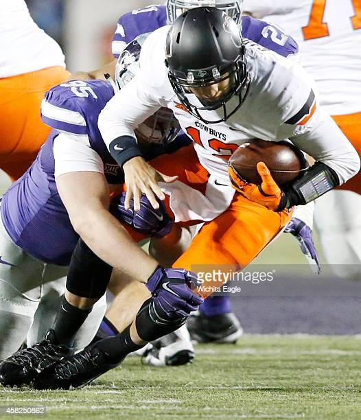 Kansas State defensive lineman Travis Britz sacks Oklahoma State quarterback Daxx Garman in the second quarter at Bill Snyder Family Stadium in...