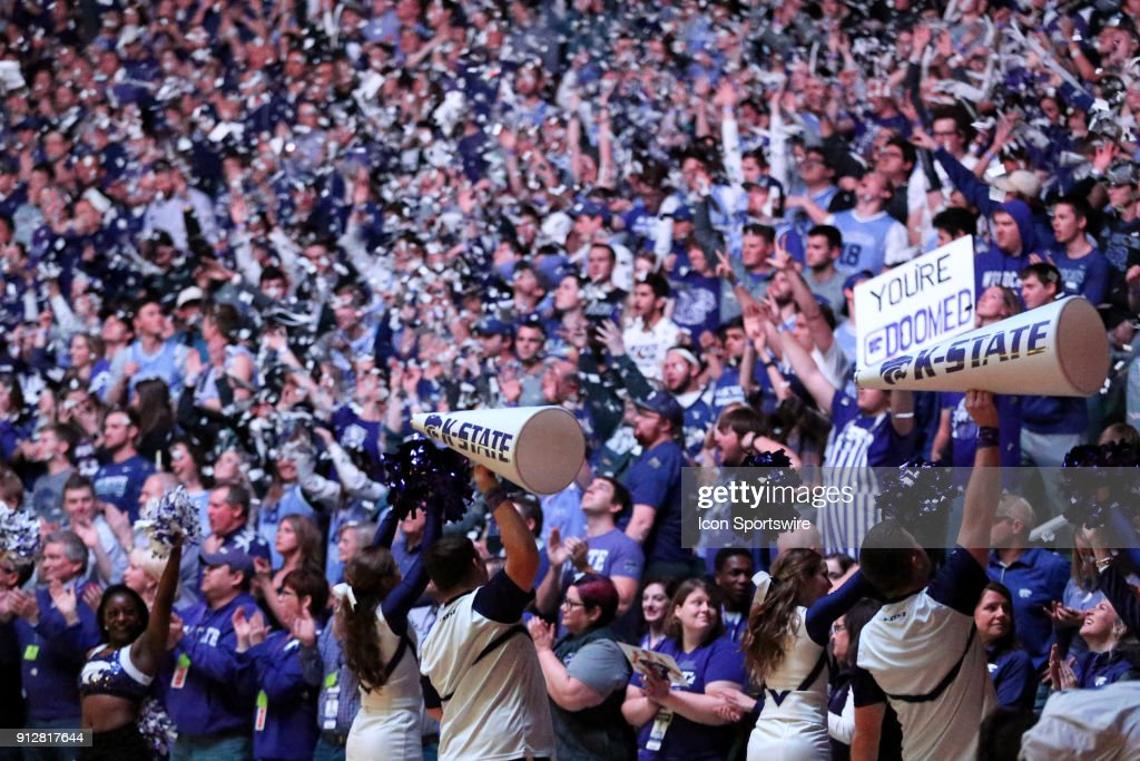 Kansas State fans throw newspaper clippings during player introductions before a Big 12 matchup between the Kansas Jayhawks and Kansas State Wildcats on January 29, 2018 at Bramlage Coliseum in Manhattan, KS.