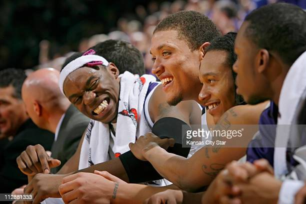 Kansas State freshman Michael Beasley center and freshman teammate Bill Walker with headband had plenty of time to laugh on the bench in the second...