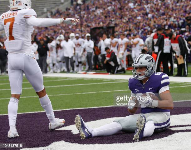 Kansas State fullback Adam Harter sits in the end zone after dropping a pass from quarterback Alex Delton as time ran out in the first half against...