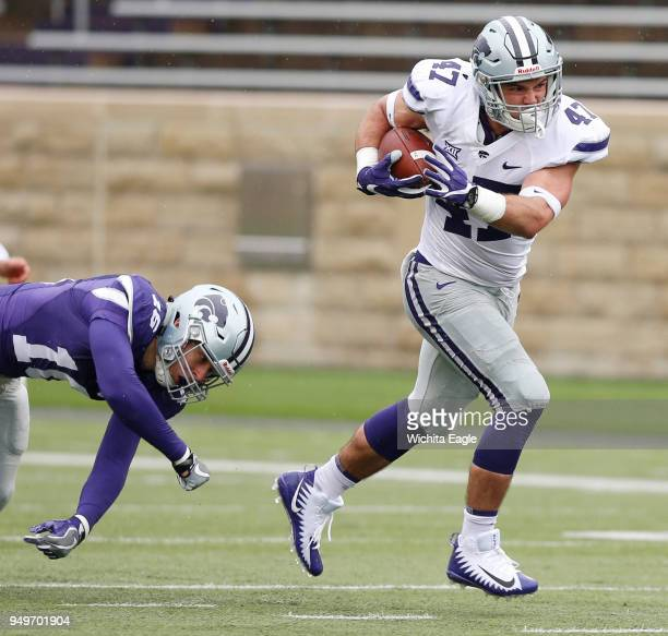 Kansas State fullback Luke Sowa breaks free of a tackle and heads for the end zone and touchdown during the annual Spring Game at KState in Manhattan...