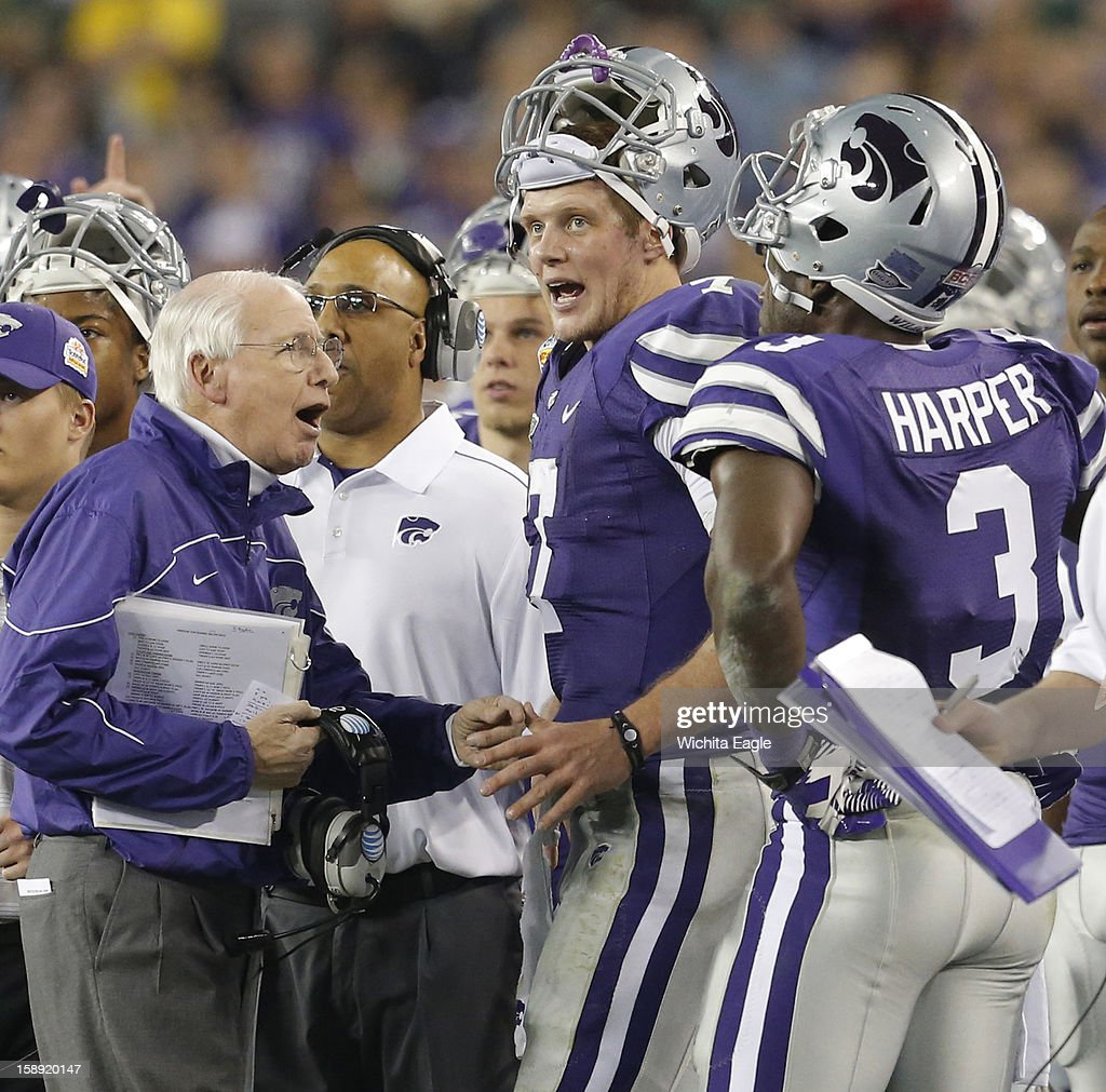 Kansas State head coach Bill Snyder talks with quarterback Collin Klein (7) in the second quarter in the Tostitos Fiesta Bowl at the University of Phoenix Stadium in Glendale, Arizona, on Thursday, January 3, 2013.