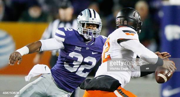 Kansas State linebacker Dakorey Johnson pressures Oklahoma State quarterback Daxx Garman in the first half at Bill Snyder Family Stadium in Manhattan...