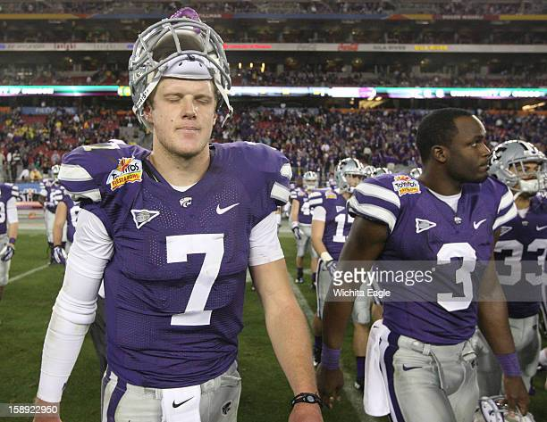 Kansas State quarterback Collin Klein fights his emotions as he leaves the field with fellow senior Chris Harper after a 3517 loss to Oregon in the...