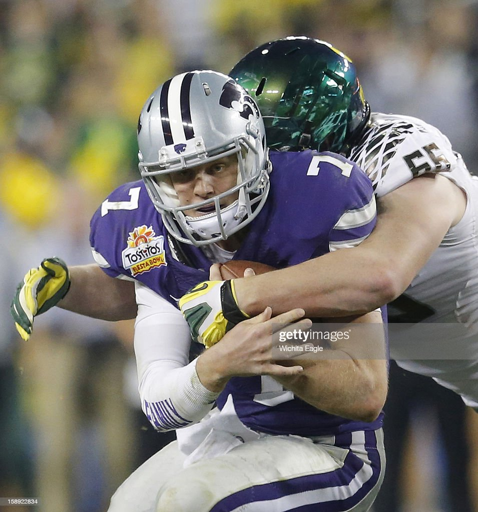 Kansas State quarterback Collin Klein (7) is stopped by Oregon defensive tackle Taylor Hart (66) late in the third quarter in the Tostitos Fiesta Bowl at the University of Phoenix Stadium in Glendale, Arizona, on Thursday, January 3, 2013. Oregon defeated K-State, 35-17.