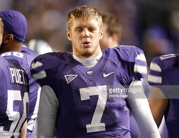 Kansas State quarterback Collin Klein winces on the sideline after leaving the game in the third quarter against Oklahoma State at Bill Snyder Family...