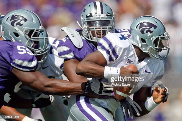 Kansas State quarterback Daniel Sams right is sacked by Tre Walker middle and Adam Davis left during the second half of Kansas State's spring game at...
