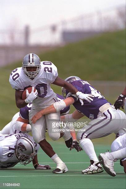 Kansas State RB Mike Lawrence is hit by LB Shelby Wehrman during KSU's annual intersquad spring game on May 3 1997 at Wagner Field in Manhattan Kan