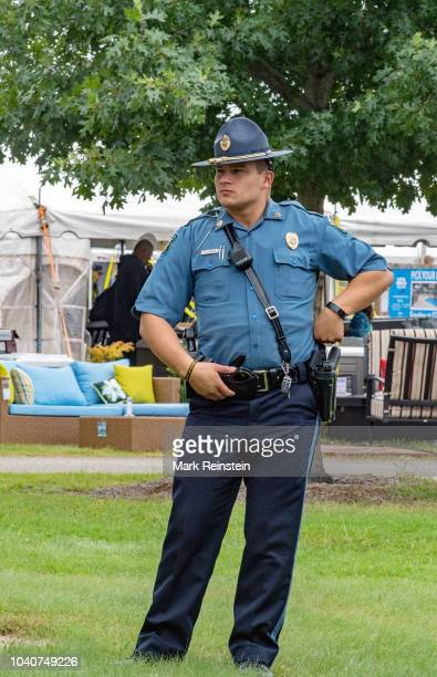Kansas State troopers provide security during the Gubernatorial debate at the Kansas State Fair, Hutchinson, Kansas, September 8, 2018.