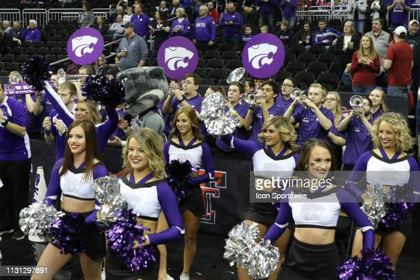 Kansas State Wildcats cheerleaders and the band before of a semifinal Big 12 tournament game between the Iowa State Cyclones and Kansas State...