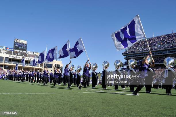 Kansas State Wildcats Cheerleaders rush onto the field before a game against the Kansas Jayhawks on November 7, 2009 at Bill Snyder Family Stadium in...