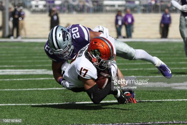 Kansas State Wildcats defensive back Denzel Goolsby tackles Oklahoma State Cowboys wide receiver Dillon Stoner in the third quarter of a Big 12...