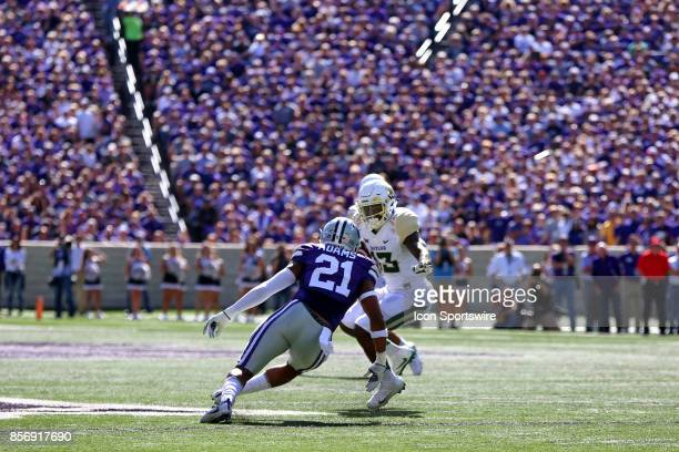 Kansas State Wildcats defensive back Kendall Adams prepares to tackle Baylor Bears wide receiver Tony Nicholson in the first quarter of a Big 12 game...