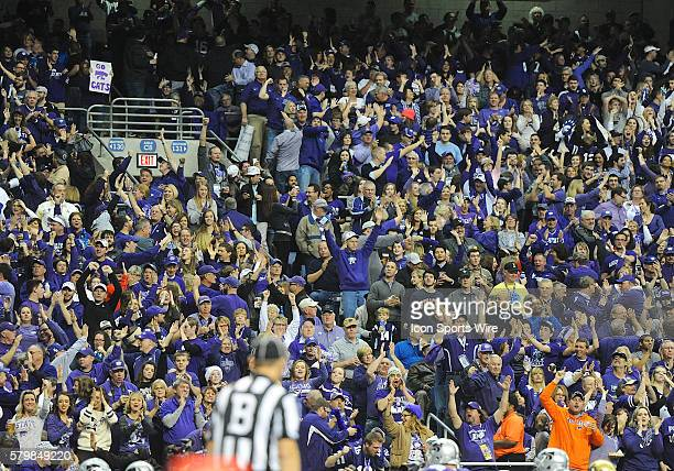 Kansas State Wildcats fans celebrate a touchdown during the 2015 Alamobowl in the Alamodome in San Antonio Texas