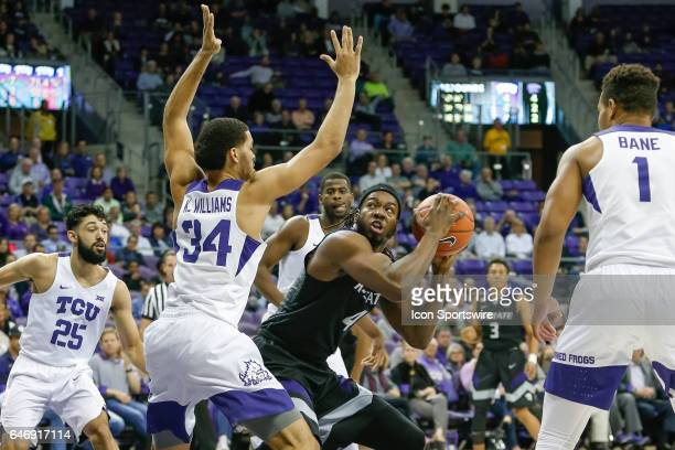 Kansas State Wildcats forward DJ Johnson is challenged in the lane by TCU Horned Frogs guard Kenrich Williams during the basketball game between...