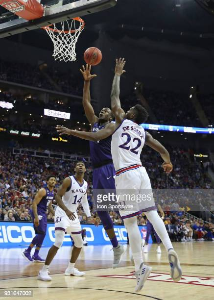 Kansas State Wildcats forward Makol Mawien beats Kansas Jayhawks forward Silvio De Sousa for an easy bucket in the second half of a semifinal game in...