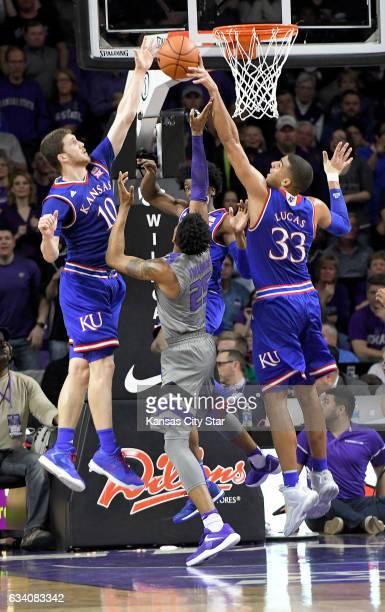 Kansas State Wildcats forward Wesley Iwundu gets blocked by Kansas Jayhawks guard Sviatoslav Mykhailiuk, forward Landen Lucas and guard Josh Jackson...