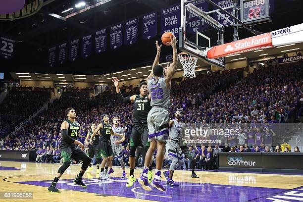 Kansas State Wildcats forward Xavier Sneed grabs the rebound over Baylor Bears forward Terry Maston in the first half of a Big 12 basketball matchup...