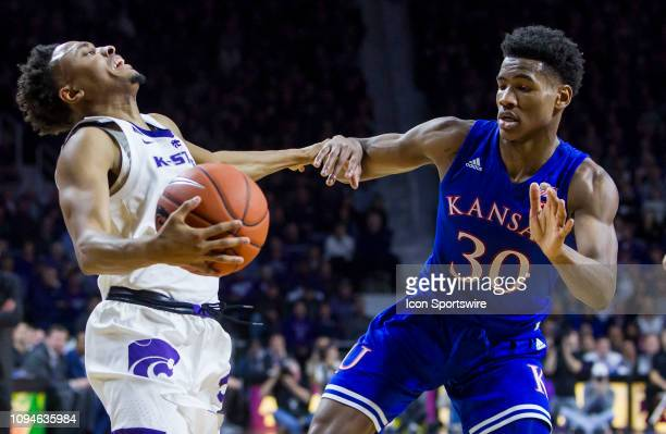 Kansas State Wildcats guard Kamau Stokes is fouled by Kansas Jayhawks guard Ochai Agbaji during the Big 12 regular season game between the Kansas...