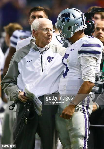 Kansas State Wildcats Head Coach Bill Snyder congratulates his quarterback during the NCAA football Cactus Bowl game between the Kansas State...