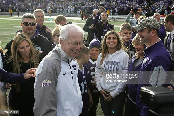 Kansas State Wildcats head coach Bill Snyder is congratulated by his family after his 200th career win as a coach at Bill Snyder Family Stadium on...