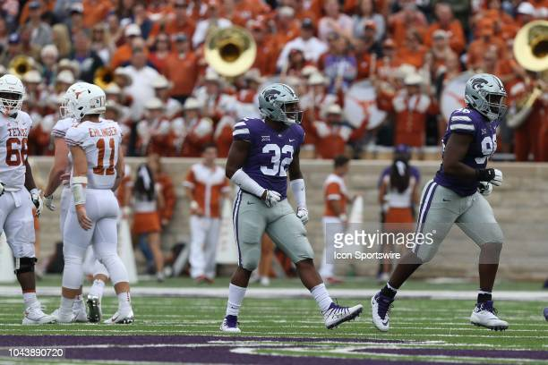 Kansas State Wildcats linebacker Justin Hughes celebrates a third down stop in the second quarter of a Big 12 matchup between the Texas Longhorns and...