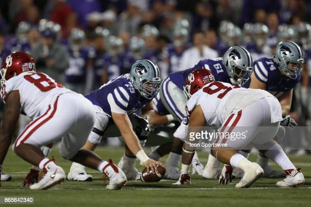 Kansas State Wildcats offensive lineman Adam Holtorf and Oklahoma Sooners defensive tackle Marquise Overton square before the snap in the fourth...