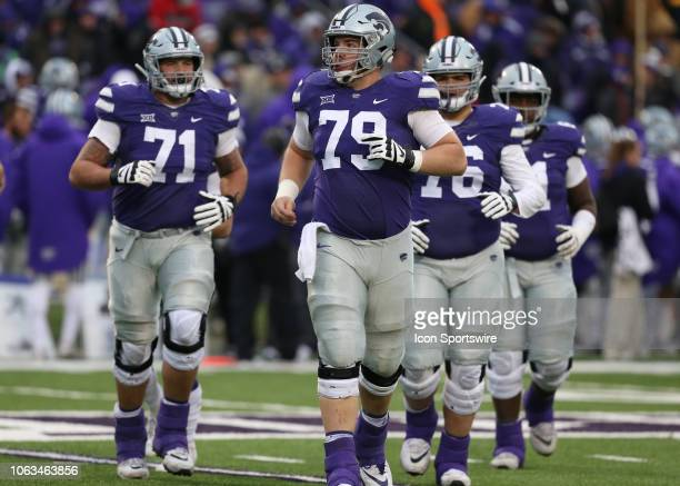 Kansas State Wildcats offensive lineman Adam Holtorf leads the team onto the field during a Big 12 football game between the Texas Tech Red Raiders...