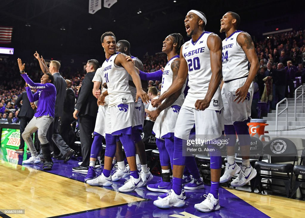 Kansas State Wildcats players celebrate on the bench as they defeat the Oklahoma Sooners during the second half on January 16, 2018 at Bramlage Coliseum in Manhattan, Kansas.