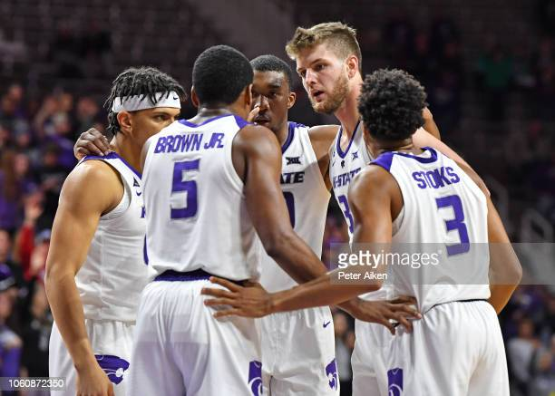 Kansas State Wildcats players huddle after a foul against the Denver Pioneers during the second half on November 12 2018 at Bramlage Coliseum in...