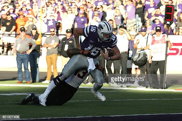 Kansas State Wildcats quarterback Jesse Ertz is tackled by Oklahoma State Cowboys safety Jordan Sterns during the Oklahoma State Cowboys game versus...