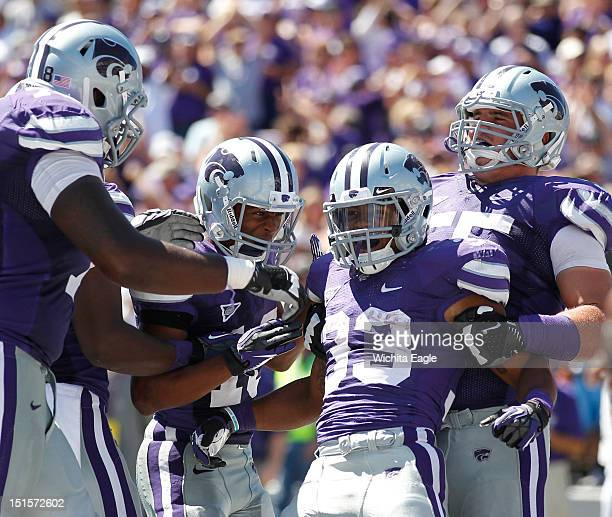 Kansas State Wildcats running back John Hubert is pulled to his feet by teammates after his touchdown in the fourth quarter in Manhattan Kansas...