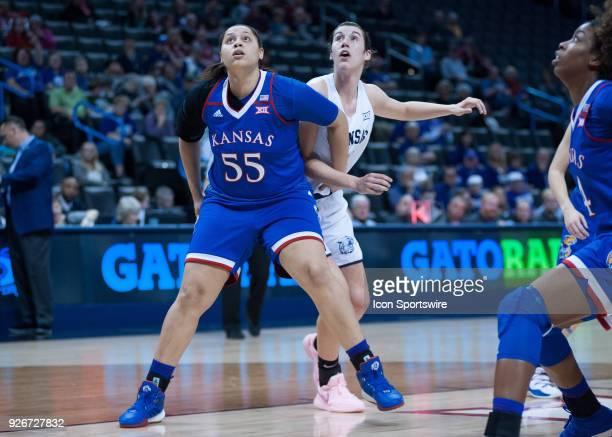 Kansas Tyler Johnson blocking out Kansas State Kaylee Page during the Kansas Jayhawks Big 12 Women's Championship game versus the Kansas State...