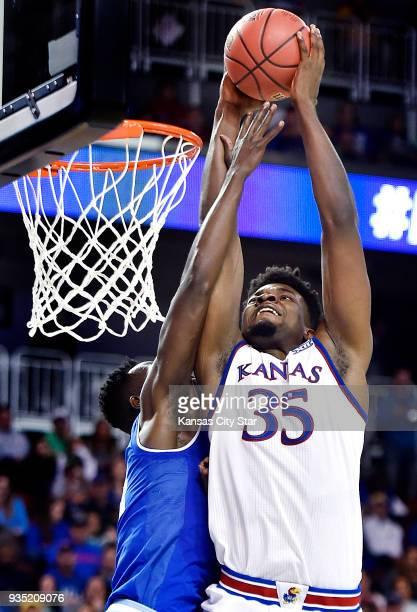 Kansas' Udoka Azubuike dunks over Seton Hallaposs Ismael Sanogo left in the second half during the second round of the NCAA Tournament at Intrust...