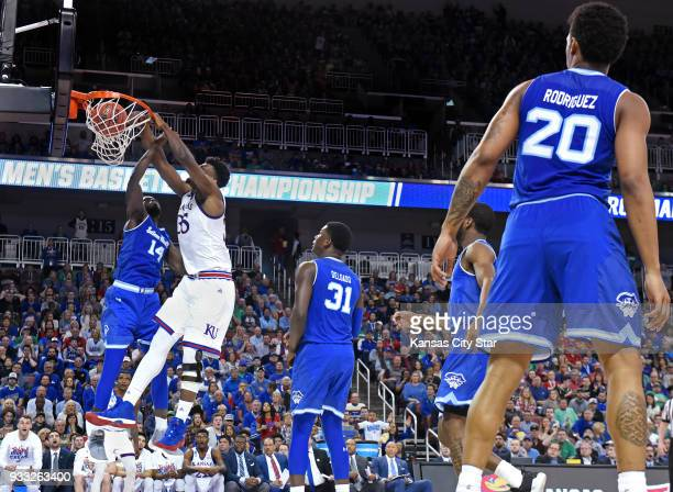 Kansas' Udoka Azubuike dunks over Seton Hall's Ismael Sanogo left in the second half during the second round of the NCAA Tournament at Intrust Bank...