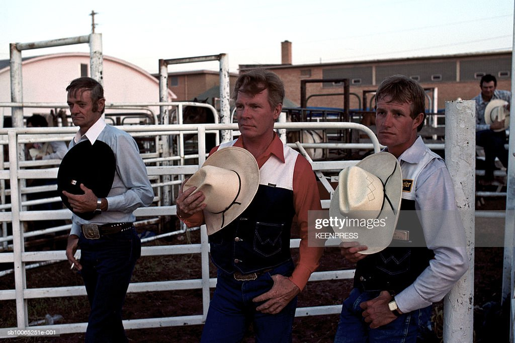 Kansas, USA - Cowboys respectfully take off their hats for the Star Spangled Banner before the start the rodeo.; 2007:10:05