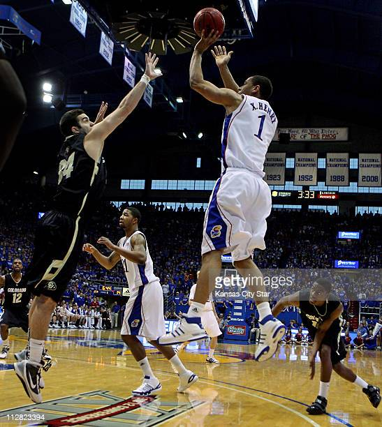 Kansas' Xavier Henry right puts up a shot during firsthalf action against Colorado at Allen Fieldhouse in Lawrence Kansas Saturday February 20 2010