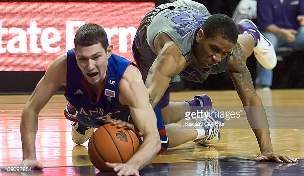 Kansas's Tyrel Reed and Kansas State's Rodney McGruder dive for a loose ball during the first half of play Monday February 14 in Manhattan Kansas