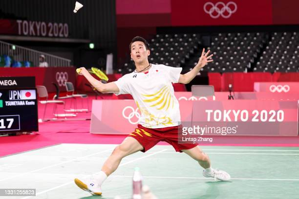 Kanta Tsuneyama of Team Japan competes against Anthony Sinisuka Ginting of Team Indonesia during a Men's Singles Round of 16 match on day six of the...